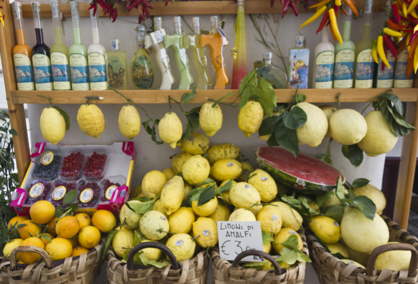 AMALFI, ITALY - AUG 12 2014: Amalfi limoncello's souvenir shop. A display of the typical Limoncello liquer in bottles of different shapes and sizes