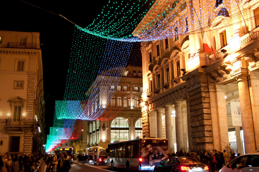 ROME; ITALY, DECEMBER 09. On the occasion of the 150th anniversary of the unification of Italy iduring the Christmas holidays Via del Corso has been decorated by long series of light-colored Italian flag, December 09 2011