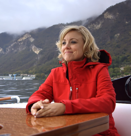 DoI-S1---Piedmont--Kathy-in-Riva-Boat-with-Red-Jacket